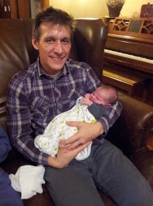 Me, Travel Weary with New Nephew, Oct 2013