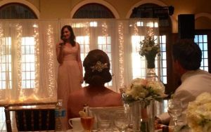 "The extremely talented sister of the bride singing ""Someone to Watch Over Me"""