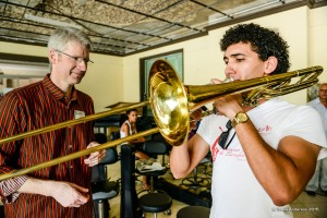 Principal Trombone Doug Wright works with a young trombonist at Instituto Superior de Arte in Havana. Wright subsequently gave the young man two mouthpieces for his instrument.  Photo by Travis Anderson